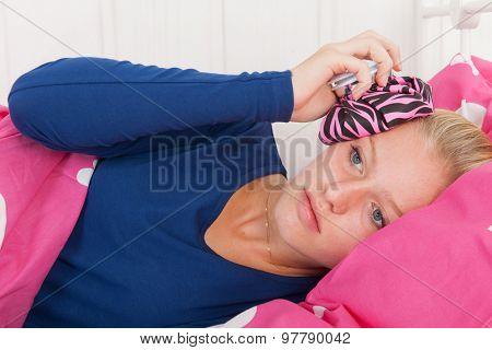 Fourteen year old girl is having a headache