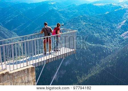 People Taking Photo At Panoramic Mountain Viewpoint Eagle Eye, Orlovo Oko In Rhodope