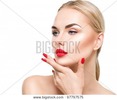 Beautiful fashion model girl with blond hair. Red lipstick and nails. Portrait of glamour woman with bright makeup isolated on white background. Beauty female face close up with perfect make up