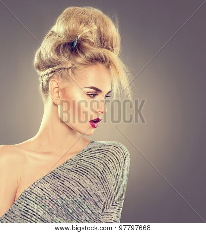 High Fashion Model Girl Portrait with Updo hair style. Beauty Woman with Modern Hairstyle and perfect glamour make up. Blonde hair. Beautiful blond lady headshot
