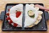 Casabe (bammy beiju bob biju) - flatbread made from cassava (tapioca) with strawberry and banana on pun. Selective focus poster
