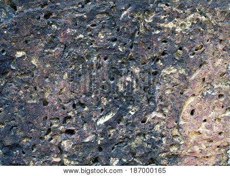 close-up surface of brick wall or floor made of porous stone, abstract texture background