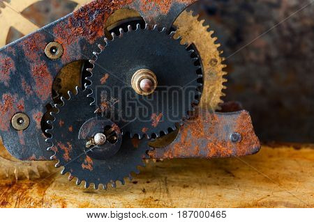 Rusty cogs gear mechanical transmission. industrial machinery vintage design wheels on grungy corroded metallic background. Shallow depth field, selective focus.