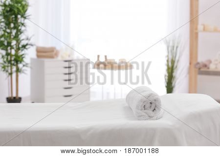 Towel on massage table in modern spa salon