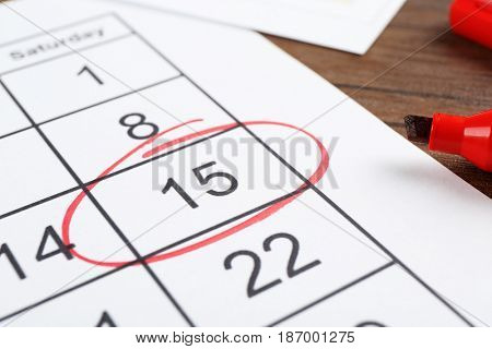 Marked calendar on table. Tax concept