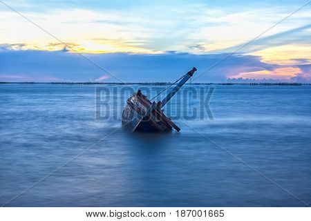 Shipwreck or wrecked boat on beach, Thailand