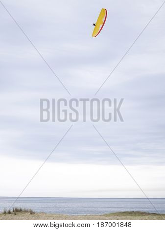 Hispanic man paragliding