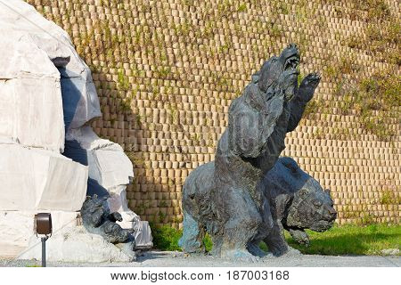 Editorial.Khanty-Mansiysk Yugra Russia August 12 2012 Archeopark Samarovo town The sculptural composition Cave bear with bear cub
