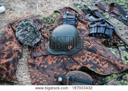 01 October 2016. A historical reenactment of the Wars History in Kiev, Ukraine. A military uniform on a German soldier: clothes, helmet, canteen.