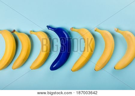 Top View Of Yellow And Blue Bananas Isolated On Blue, Ripe Bananas