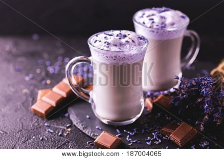 Cappuccino With Lavender And Chocolate Syrup And Flowers