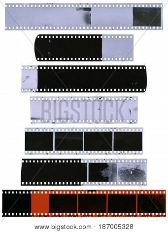 Old used dusty and scratched celluloid film strips isolated on white background
