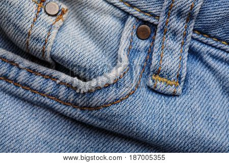 Denim Jeans Texture Background With Torn. The Texture Of The Colored Cotton Fabric. Stitched Texture