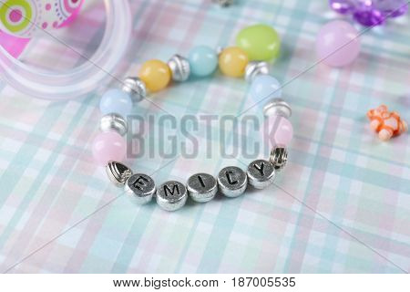 Bracelet with baby name on table