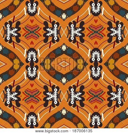 Seamless background from a floral ornament orange tribal style. Ethno. Vector illustration.