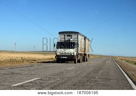 Betpak Dala desert.Road and truck near former Soviet  anti-ballistic missile testing range Sary Shagan. Bank of Lake Balkhash.May 7, 2017.Priozersk.Kazakhstan