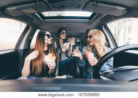 Friendship And Time Together On Road. Three Young And Beauty Women Have Fun Together Eating Fast Foo