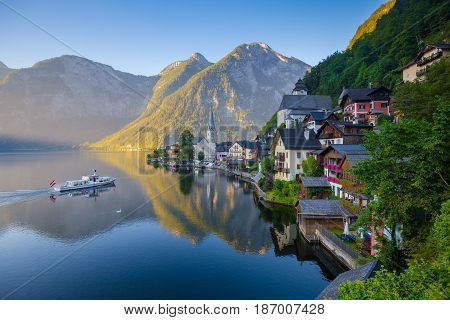 Classic View Of Hallstatt With Ship At Sunrise, Salzkammergut, Austria