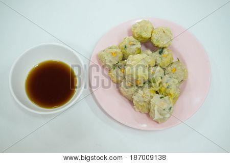 Chinese steamed dumplings (Dim Sum) with sauce is a chinese food in chinese restaurant