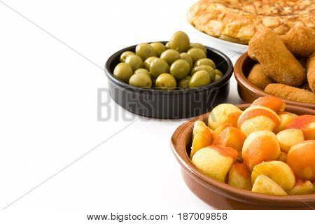 Traditional spanish tapas. Croquettes, olives,  ham and patatas bravas isolated on white background