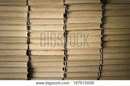 Stacking books in library. Education concept background.