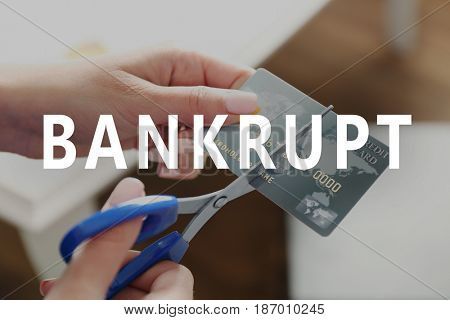 Concept of bankruptcy. Woman cutting credit cars with scissors, closeup
