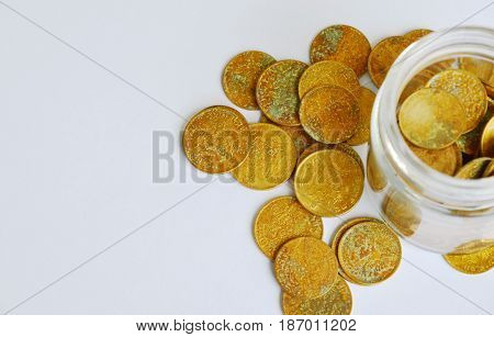 old gold coin in glass bottle on white background