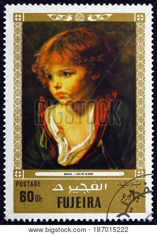 FUJEIRA - CIRCA 1972: a stamp printed in the Fujeira shows a Blond Haired Boy with an Open Shirt Painting by Jean Baptiste Greuze French Painter circa 1972