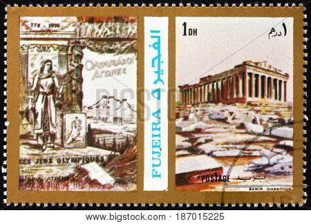FUJEIRA - CIRCA 1972: a stamp printed in the Fujeira shows Poster of Athens 1896 Olympics Acropolis circa 1972