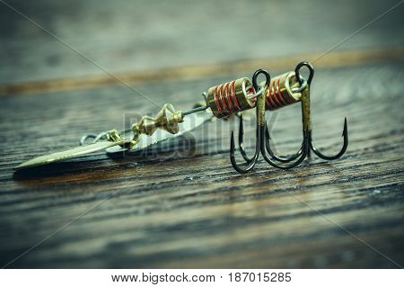 fishing hooks on ols wooden table Tri-hook for fishing