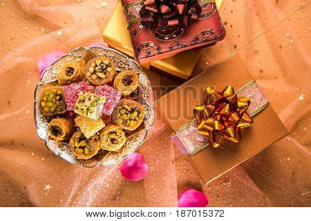 Eid festival gift background. A top view of middle eastern sweet and many gift packs arranged together.