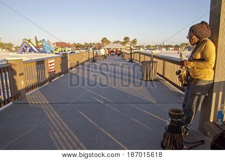 Clearwater Beach; Florida; USA - January 24, 2017: A busker plays the saxophone for tips on Pier 60