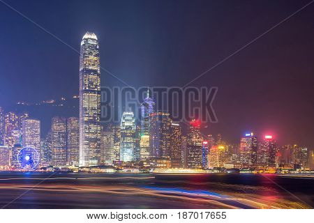Hong Kong skyline at night. long exposure used, lighting on boat making light tails.