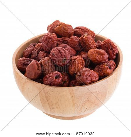 Dried Jujube Fruits In Wooden Bowl Chinese Herbal Medicine On A White Background
