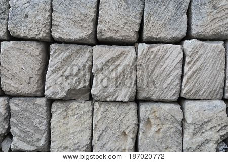 rustic ancient handcraft tile stack stone wall in Matera italy.