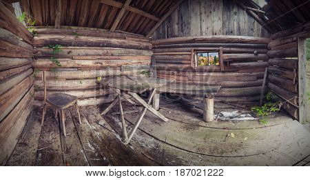 Panorama of old rustic wooden house. View from inside