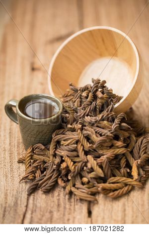 East Indian Screw Tree And Tea ,thai Herb For Health On Wooden Background