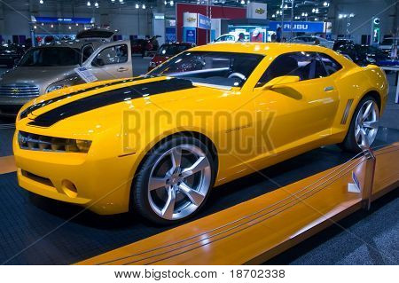 Yellow sports car at auto show