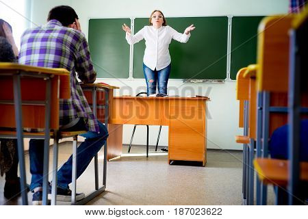 Angry female teacher is yelling at students