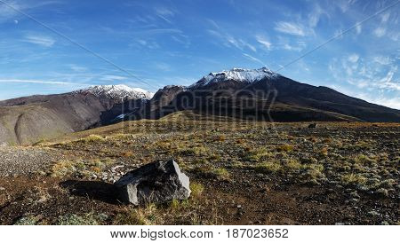 Panorama - volcanic landscape of Kamchatka Peninsula: autumn view of Kozelsky Volcano on sunny day. Avachinsky-Koryaksky Group of Volcanoes Kamchatka Region Russian Far East Eurasia.