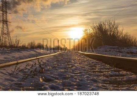 Railway road in the light of the sun. Travel by train concept.