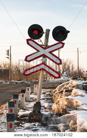 Railway traffic light on the railroad crossing.