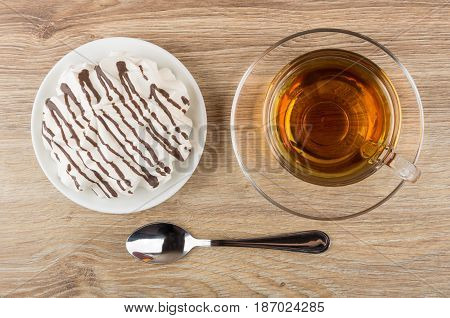 Striped Meringue With Chocolate In Saucer, Cup Of Tea
