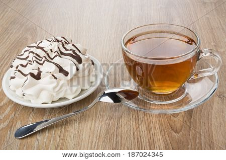 Meringue With Chocolate In Saucer, Cup Of Tea And Spoon