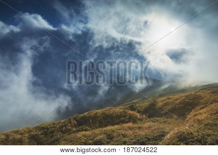 Fog Plays With Mountains