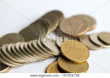 A pile of coins on white background, Selective focus