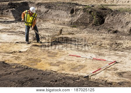 Driebergen The Netherlands - March 22 2017: Archeology excavation site with digging man in Driebergen.