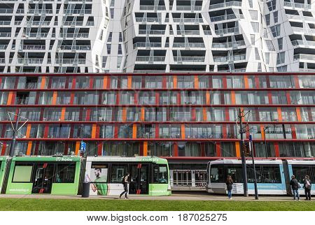 Rotterdam The Netherlands - March 10 2017: Calypso Achitectural Building with two trams in front in Rotterdam city the Netherlands
