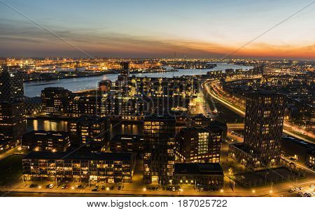 Rotterdam The Netherlands - March 24 2017: Nieuwe Maas in Evening Light with ships on the river industrial areas and the harbor of Rotterdam in the Netherlands.