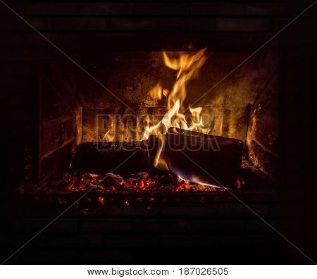 inside of stove with fire and glowing embers